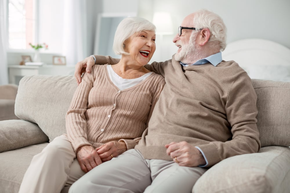 two old lovely couple in the couch wearing a nude sweater, ultra dry newcastle carpet cleaning